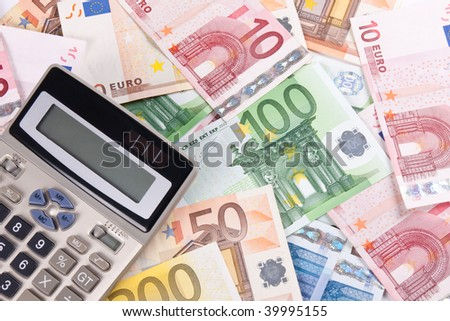 Background with different euro banknotes and calculator. - stock photo