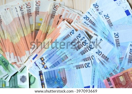 Background with euro money. Euro cash over wooden background. - stock photo
