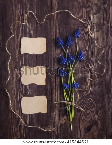 Background with fresh blue colors blank tag for text on a brown painted wooden background. Place for text. - stock photo