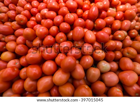 Background with fresh tomato, closeup