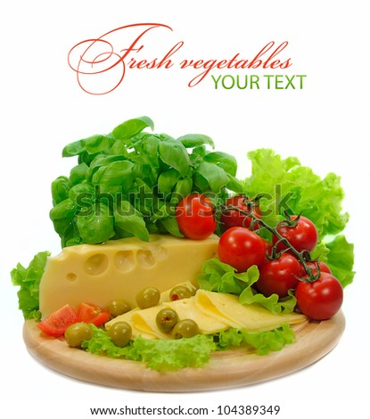 background with fresh vegetables and cheese on white background - stock photo