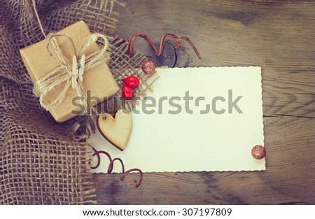 background with  gift, blank sheet paper, wooden heart - stock photo