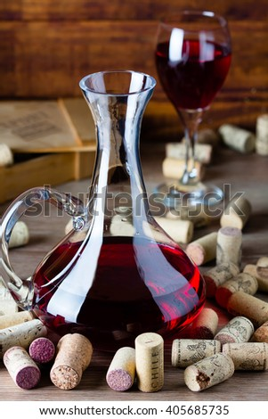 Background with glass of wine, decanter and wine corcs. Wine concept - stock photo