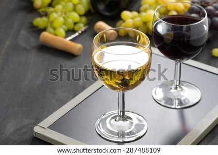 background with glasses of red and white wine, horizontal - stock photo