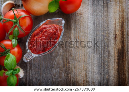 Background with homemade ketchup and tomatoes - stock photo