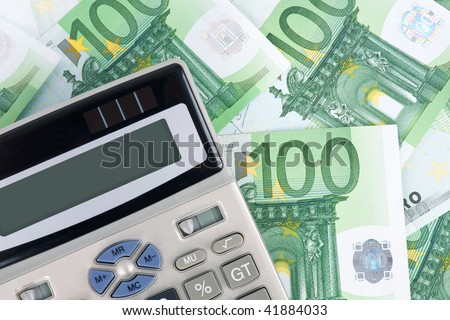 Background with hundred euro banknotes and calculator.
