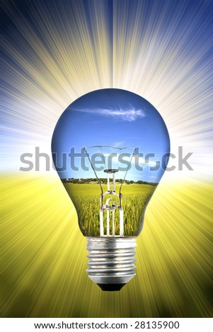 background with landscape inside light bulb - environment concept - stock photo
