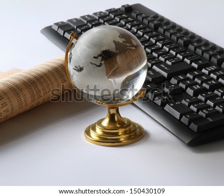Background with laptop and globe - stock photo