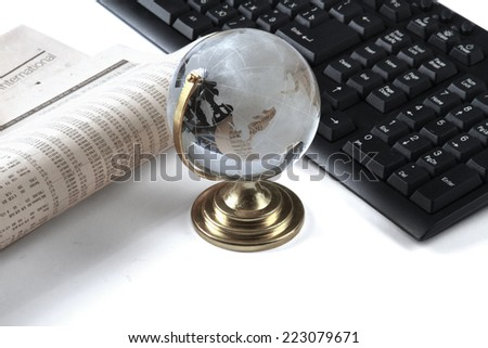 Background with laptop, document  and globe lying at the desk - stock photo