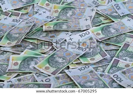 Background with many Polish 100 pln banknotes - stock photo