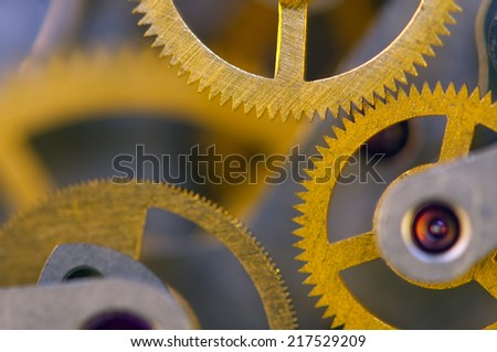 Background with metal cogwheels a clockwork.  For your successful business design. Macro. - stock photo