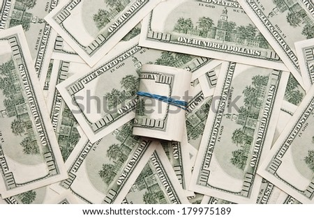 Background with money american hundred dollar bills and roll of dollars with rubber band  - stock photo