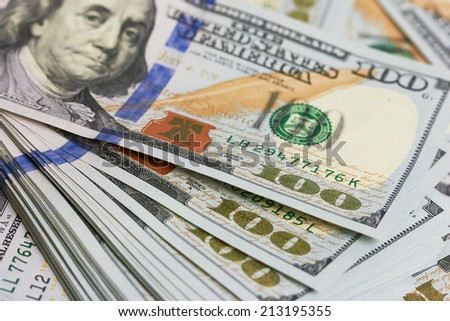 Background with money american hundred dollar bills, close up