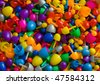 Background with multicolored random sized plastic mosaic pins - stock photo