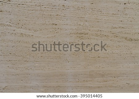 Background with natural stone texture travertine. Travertine warm beige color with pronounced a striped and does not uniform pattern. Banded texture reminiscent of wood pattern. - stock photo