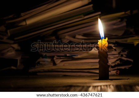 Background with old paper and candle