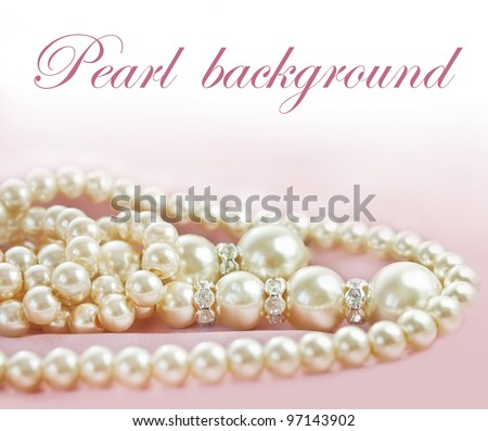 Background with Pearls  necklace on  pink silk fabric - stock photo