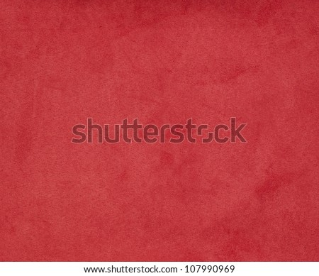 Background with red texture, velvet fabric, full frame, close-up - stock photo