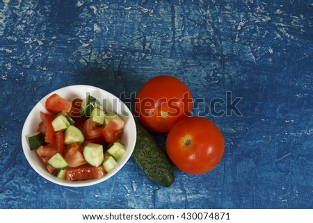 Background with salad, cucumber and tomatoes - stock photo