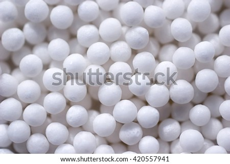 Background with spherical homeopathic pills closeup - stock photo