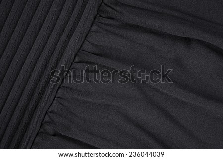 Background with texture of black fabric. Close up of a skirt