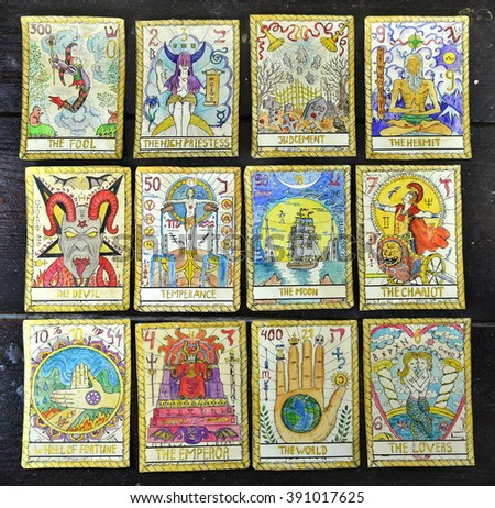 Background with the tarot cards, top view. The major arcana deck. Fortune telling seance or black magic ritual. Scary still life with occult and esoteric symbols. Halloween or divination rite - stock photo