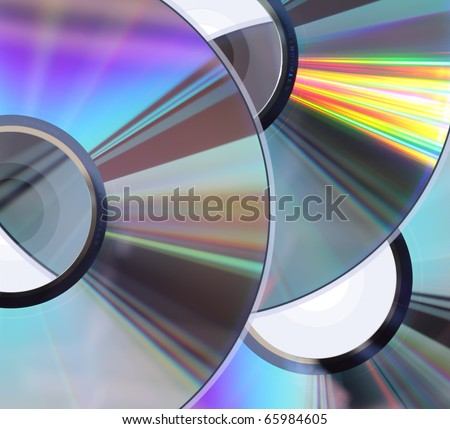 Background with three CD / DVD disks. No scratches or dust. - stock photo