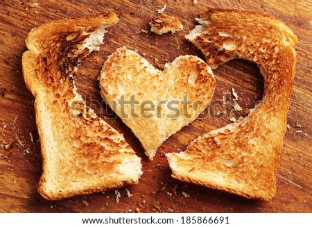 Background with toast bread in shape of hearts - stock photo