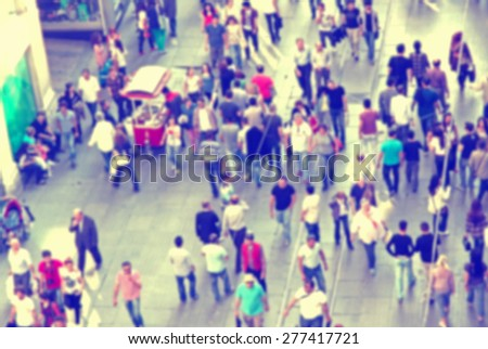 Background with unrecognizable blurred people walking on the street. Instagram ink filter - stock photo