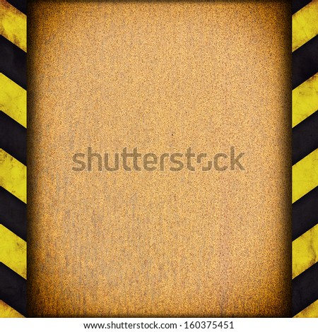 Background with warning stripes and metal rusty plate - stock photo