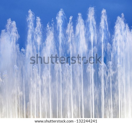 background with water from fountain on blue sky