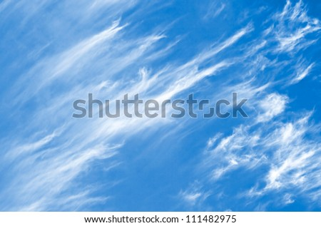 Background with white beautiful windy clouds on the blue sky - stock photo