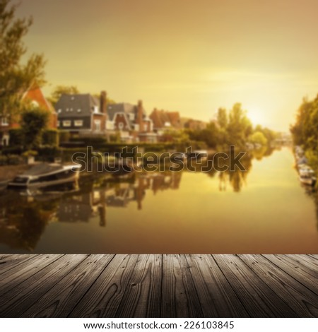 Background with wooden table and Amsterdam canal