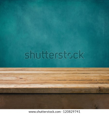 Background with wooden table and grunge blue wall - stock photo
