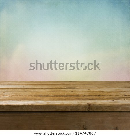 Background with wooden tabletop and dreamy texture - stock photo