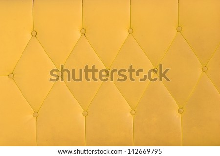 Background yellow sofa. - stock photo
