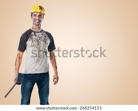 Background. Young dirty Worker Man With Hard Hat helmet  holding a hammer isolated on White Background - stock photo