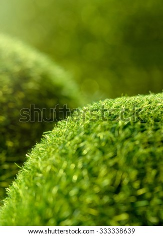 Backgrounds and textures: imitation of green grass hills, natural abstract with beauty bokeh and sunlight - stock photo
