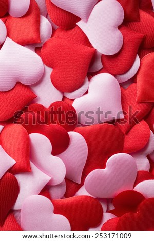 Backgrounds and textures: mix of red and pink hearts, suitable for Valentine`s day or wedding or some else romantic event - stock photo