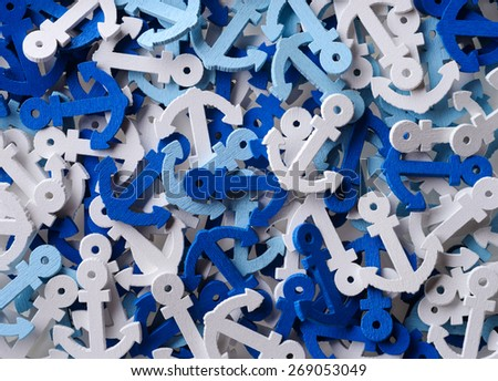 Backgrounds and textures: mix of white and blue anchors, abstract nautical background - stock photo