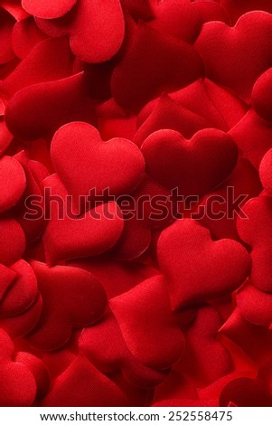 Backgrounds and textures: red hearts background, suitable for Valentine`s day or wedding or some else romantic event - stock photo