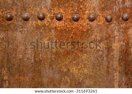 Backgrounds and textures: rusty metal surface with riveted joints, industrial abstract - stock photo