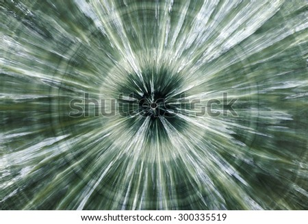 Backgrounds and textures: surface of beautiful green decorative stone, Clinochlore, abstract pattern of concentric circles and radial cracks, spots and stains, natural background - stock photo
