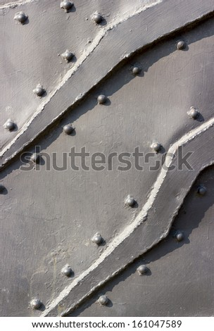 Backgrounds collection - Texture of black metal surface stell and rivet - stock photo