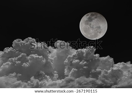 Backgrounds night sky of the full moon with clouds. - stock photo