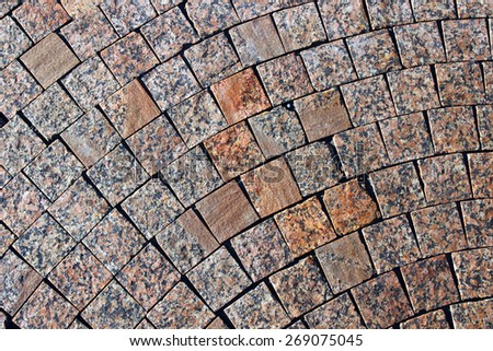 Backgrounds of pavement made of brown polished marble paving stones - stock photo