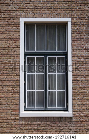 Backgrounds White window on a brick wall - stock photo