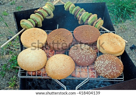 Backgrund of Tasty meat with buns on grill - stock photo