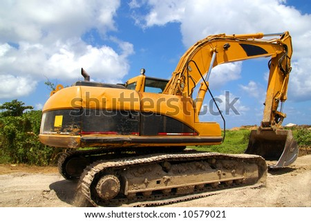 backhoe getting ready to move soil - stock photo