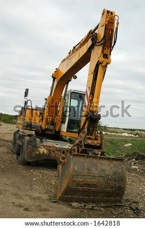backhoe in construction site - stock photo